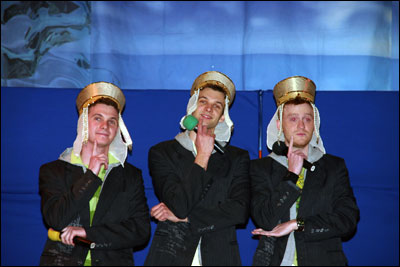 Semyon, Alexei, and Paul in costume with microphones
