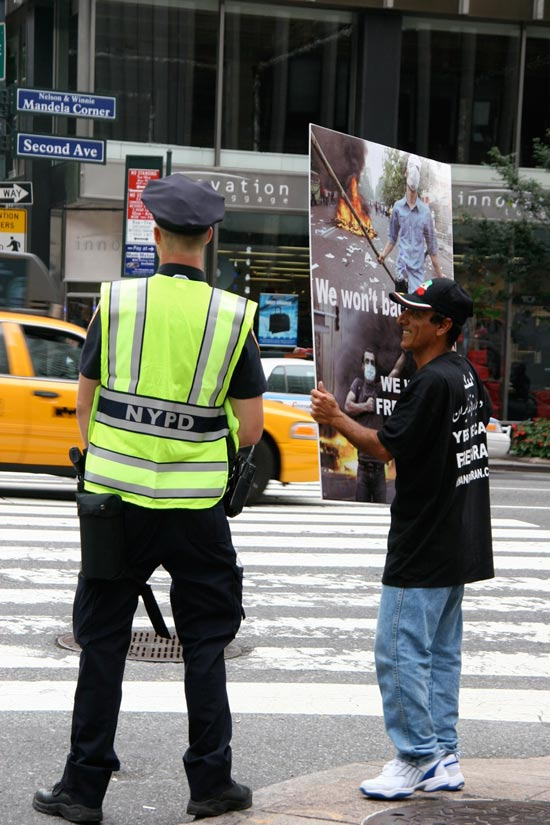 Protester and police officer on street