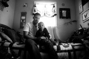 Fernando Bermudez with his son, Fernando, age 5. Mr. Bermudez finds his sons room a respite from daily stressors.