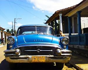 A fifties-era Buick parked on a street
