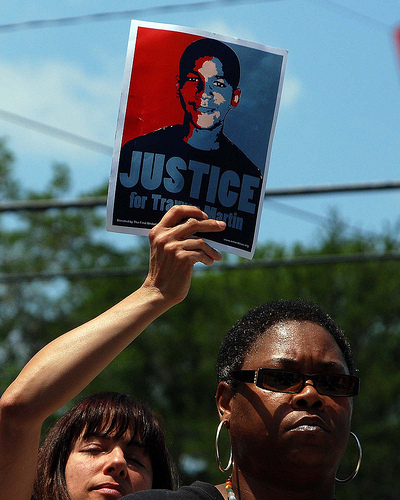 """photo of protestor holding a """"Justice for Trayvon Martin"""" sign"""
