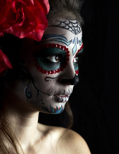 photo of a young woman with Mexican face paint.