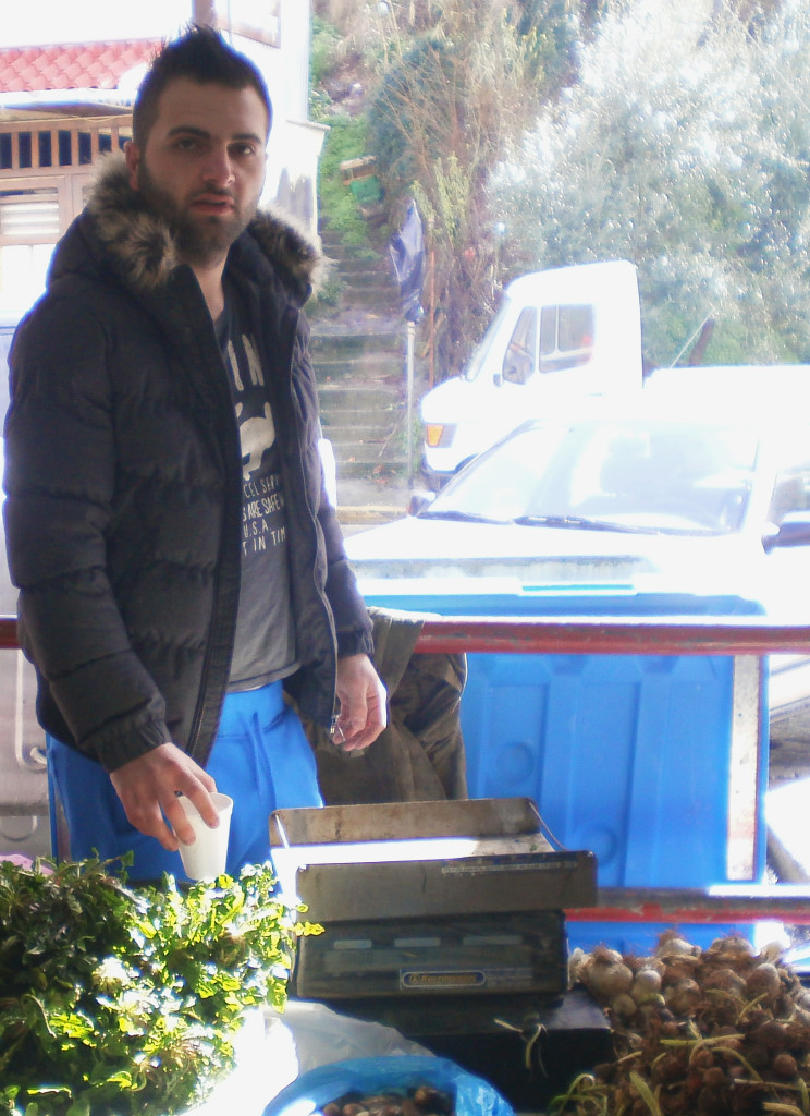 Vassilis Psonis poses at his stall in the farmers' market
