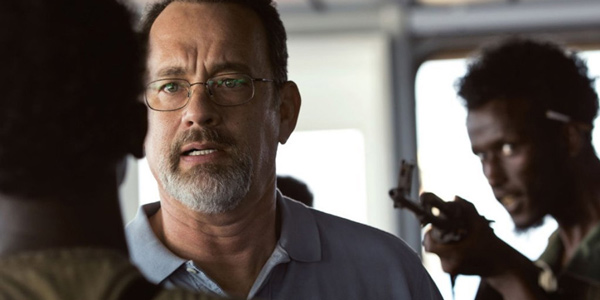 Two pirates confront Captain Richard Phillips on his captured ship