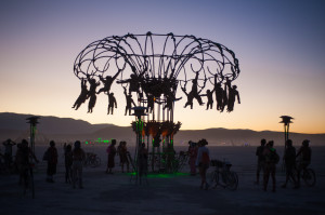An art installation on the playa featuring spinning monkeys