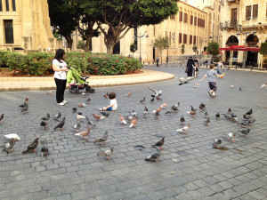 Children playing near pigeons in Beirut's Place de l'Étoile