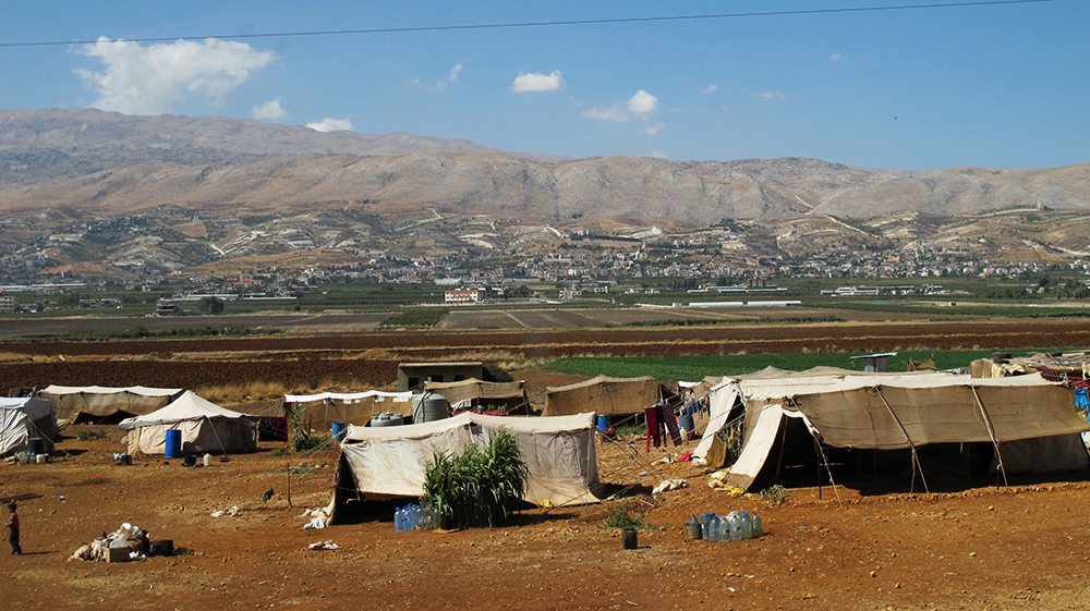 The Bekaa Valley with tents in the foreground