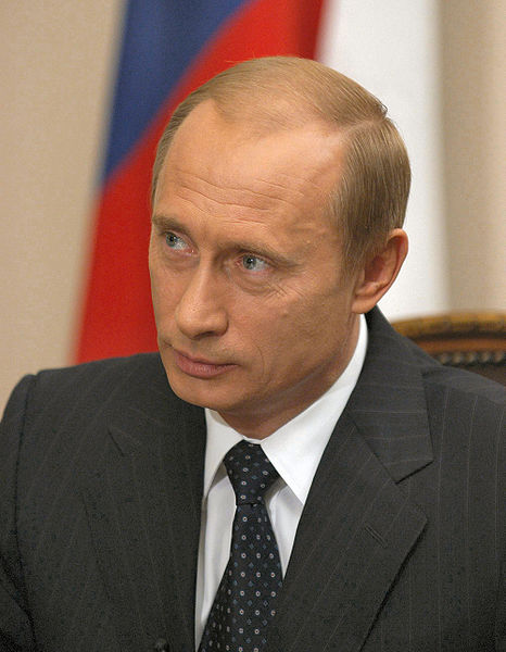 Russian president Vladimir Putin before the Russian flag