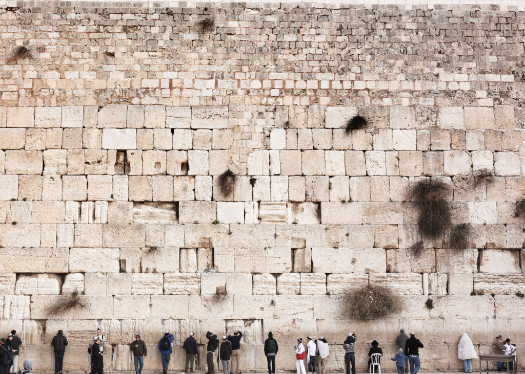 Men standing in front of the Wailing Wall