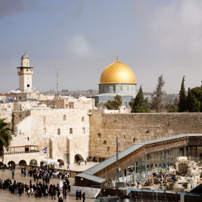 The skyline of Jerusalem's Old City, with the Wailing Wall in the foreground and the Dome of the Rock in the background
