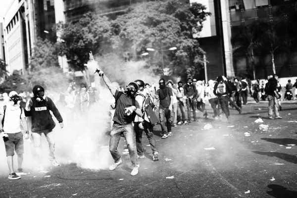 Protesters wearing gas masks on the streets of Caracas
