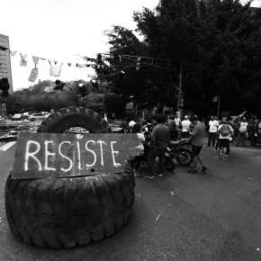 "Tire blockade with the word ""Resiste"""
