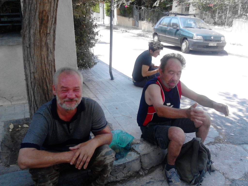 Homeless Polish immigrants sitting on curb