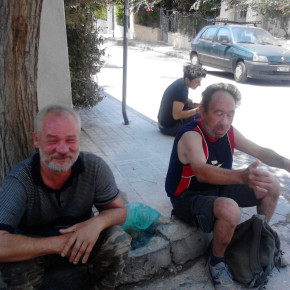 Homeless Polish immigrants sitting on the curb