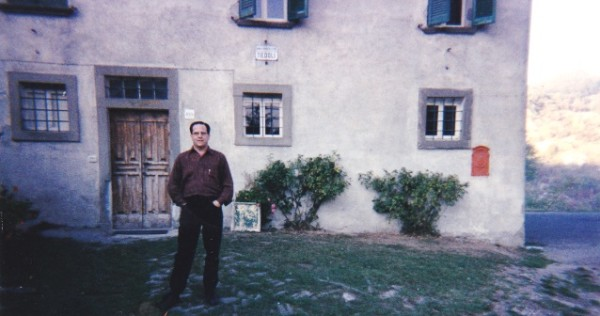 Author in front of house door and sign
