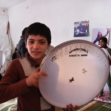 Boy poses with a drum