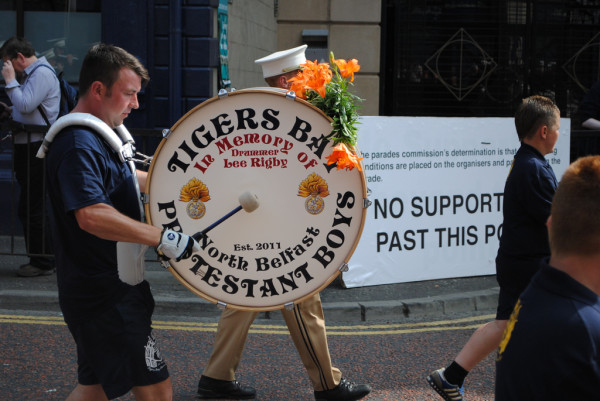 "Drummer banging drum that reads ""Protestant Boys"""