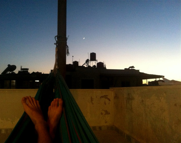 Person in a hammock on a rooftop