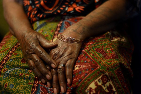 Monah Smith's hands, which she had tattooed as a young girl in Liberia