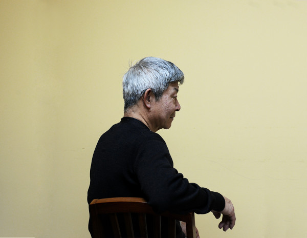 Hong, a Chinese immigrant, sits in a mental health clinic in Sunset Park, Brooklyn