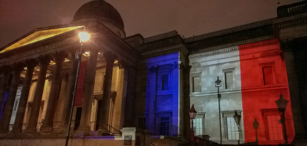 Building lit with French flag
