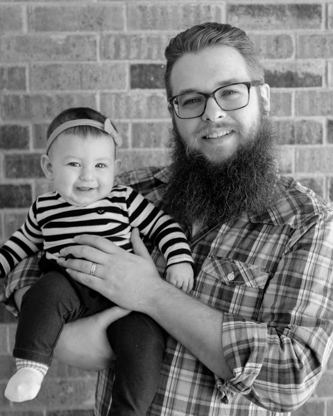 Black-and-white portrait of stay-at-home dad and his baby daughter