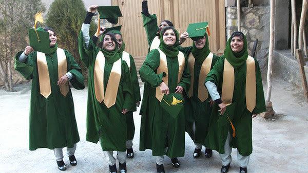 Girl graduates celebrating