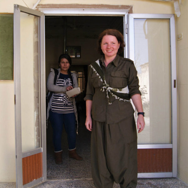 Dr. Rohani stands in the doorway of her clinic