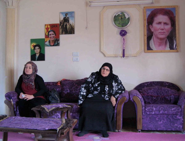 Two women sitting in the women's house in Rojava